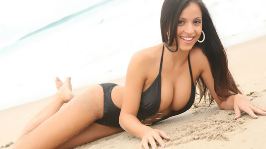 sexy janessa brazil shows off her huge tits in a tiny swimsuit at the beach
